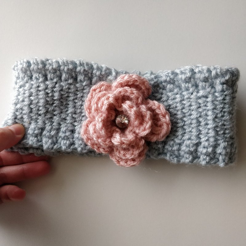 Gray ear warmer with pink flower and embellished with silver gem in the center