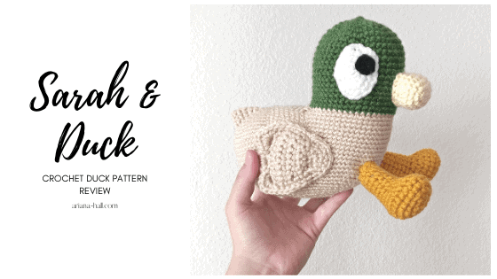 Crochet Duck from the show Sarah and Duck being held for photo.