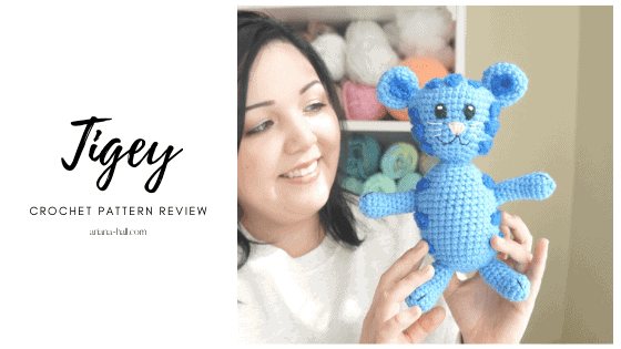 Woman holding a crochet Tigey from Daniel the tiger show.
