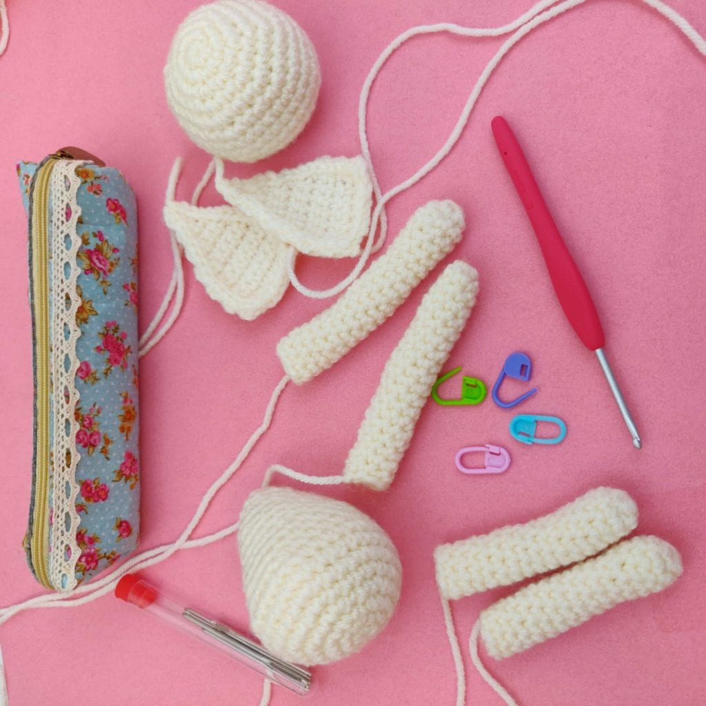 Assortment of disassembled crochet bunny doll appendages
