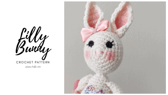 White crochet bunny with pink ribbon bow.