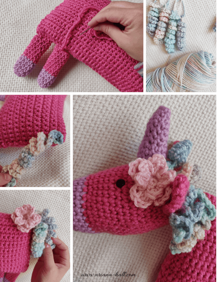 Crochet unicorn with curly mane and flowers on the head and tail.