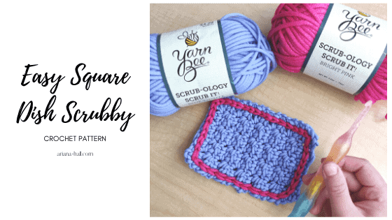 crochet hook, yarn and a square dish scrubby in purple