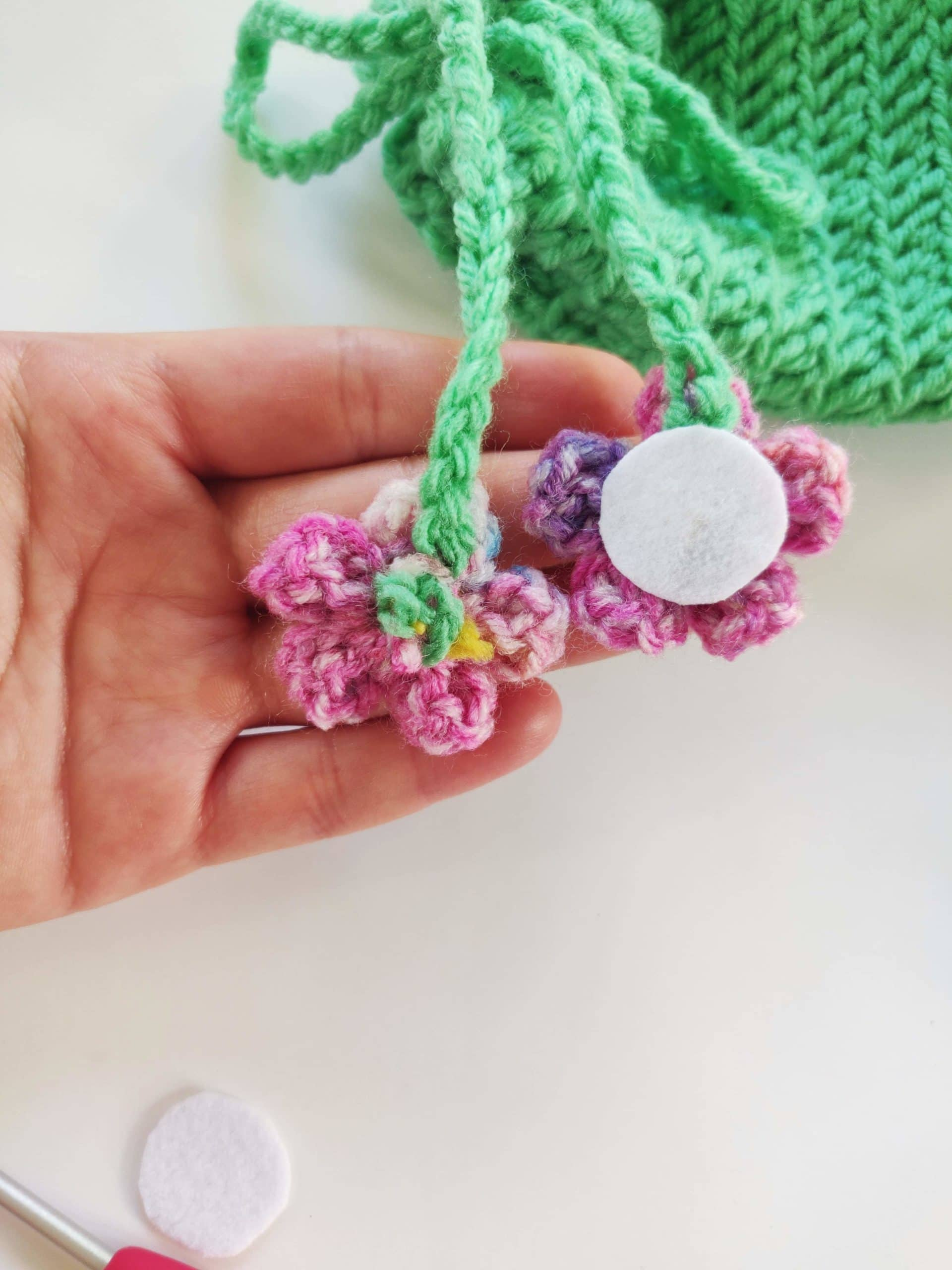 Crochet flower with piece of white felt in the back.