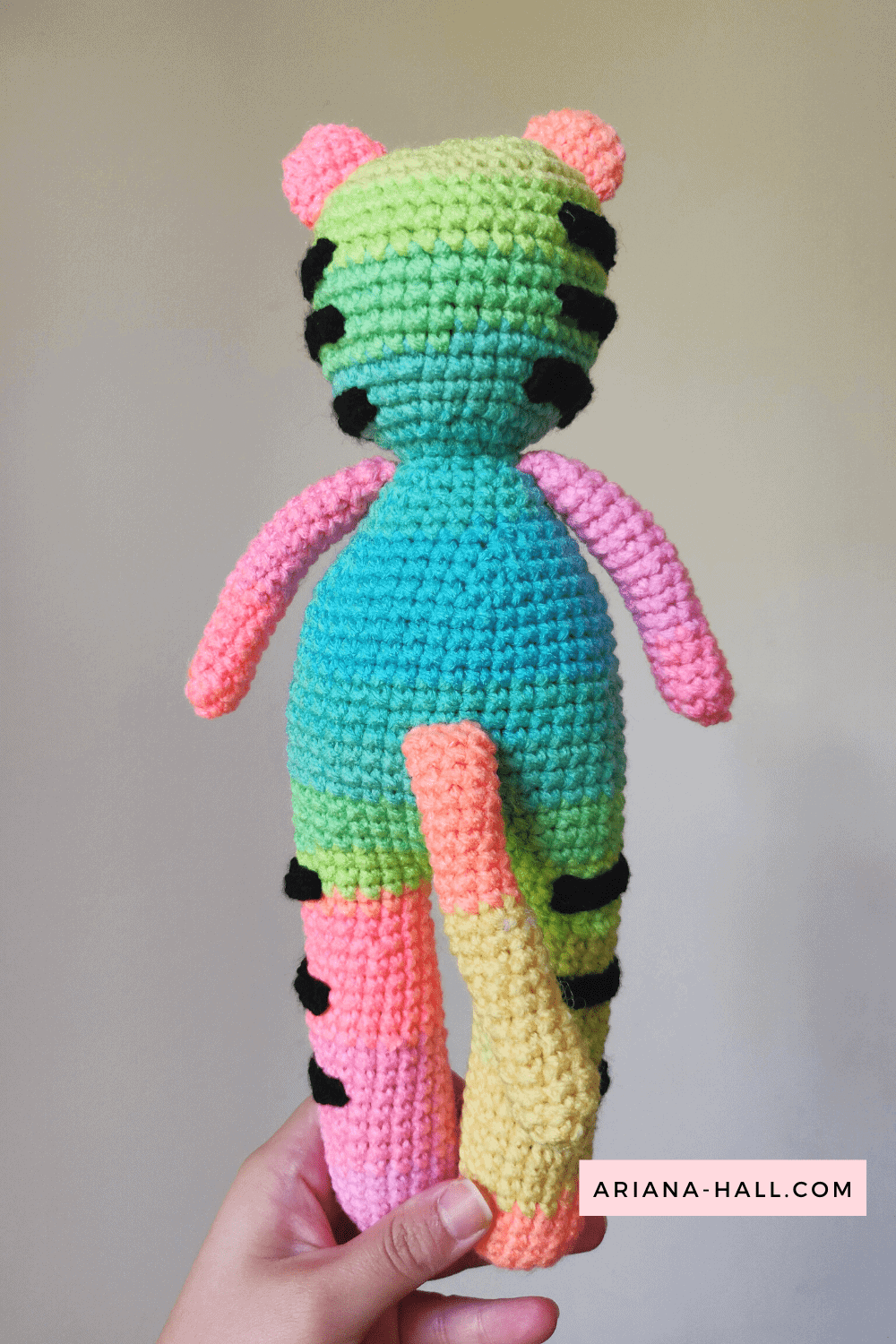 the back of the rainbow crochet Tully the Tiger.